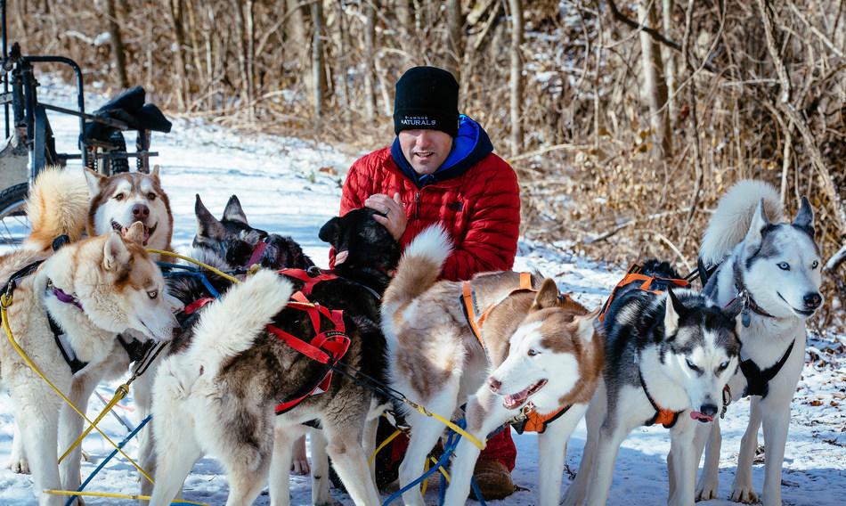 Richie Camden and the Breakaway Siberians take a break during a training run in Missouri.