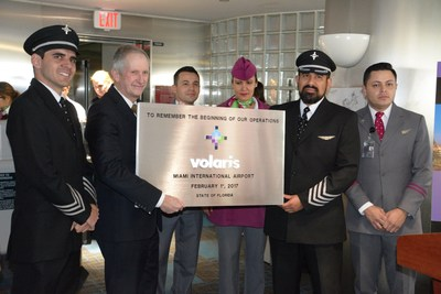 MDAD Deputy Director Ken Pyatt receives a plaque from the inaugural Volaris flight crew.