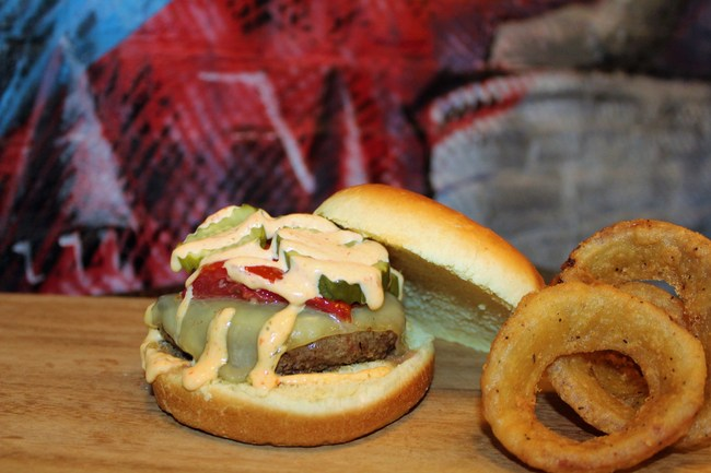 Kings of Kobe King's Classic with roasted tomato, white cheddar, pickles, cherry pepper aioli