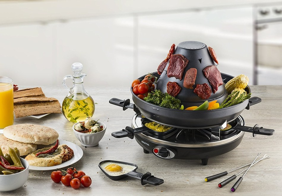Gourmia's Raclette Party Grill With Vertical Grilling Sombrero lets party goers easily create their favorite raclette dish or grill all types of food right on the spot.