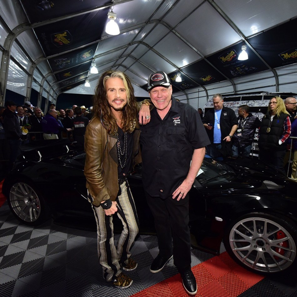 Steven Tyler and Craig Jackson get ready to auction Tyler's Hennessey Venom GT sports car for Janie's Fund at the Barrett-Jackson auction in Scottsdale, Arizona.