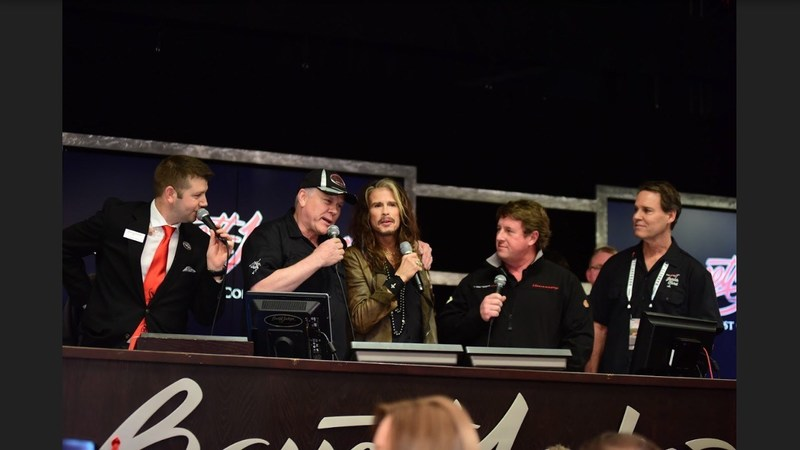 Steven Tyler auctions his rare Hennessey Venom GT sports car for Janie's Fund, his philanthropic partnership with Youth Villages. From left, the Barrett-Jackson auctioneer, Craig Jackson, Steven Tyler, John Hennessey and Youth Villages CEO Patrick Lawler.