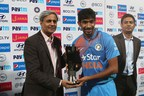 Ramesh Ramanathan, Chairman, Janalakshmi Financial Services, handing over the Jana Bankable Player of the Series Trophy to Jasprit Bumrah (PRNewsFoto/Janalakshmi Financial Services)