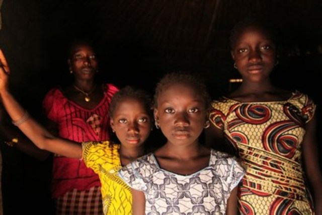 A woman and her daughters stand in their home, in the village of Cambadju in Guinea-Bissau. Their village was the first in the country to renounce female genital mutilation/cutting. © UNICEF/UNI137341/LeMoyne (CNW Group/UNICEF Canada)