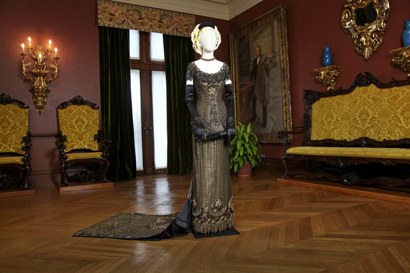 """This beaded gown, displayed here in Biltmore House, was worn by Nicole Kidman in the film, """"The Portrait of a Lady."""" The gown is one of 40 that will adorn the historic home during """"Designed for Drama: Fashion from the Classics,"""" a new exhibit opening on Feb. 10 at Biltmore in Asheville, N.C."""