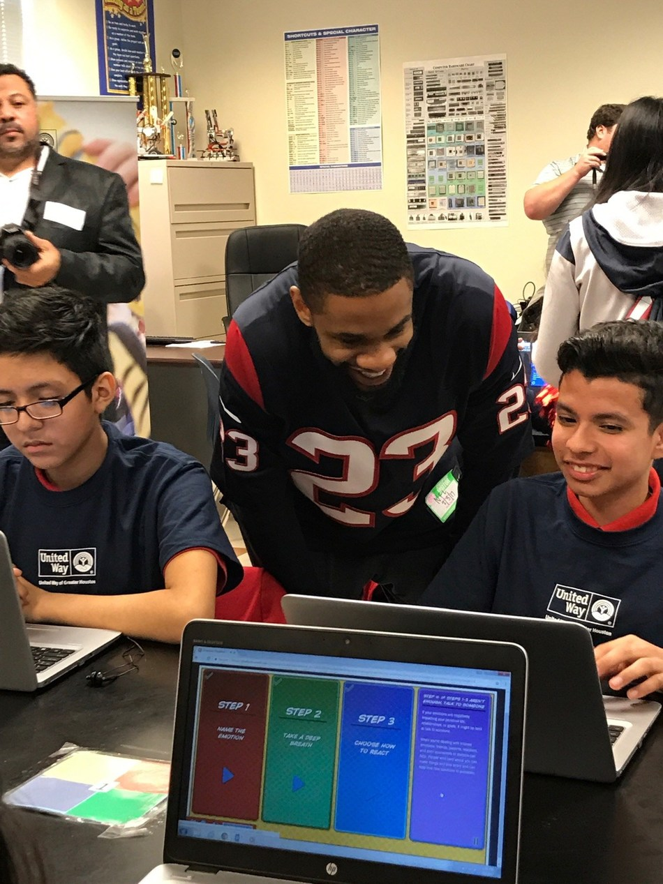 Houston Texans safety Kurtis Drummond works with a student from Pilgrim Academy.