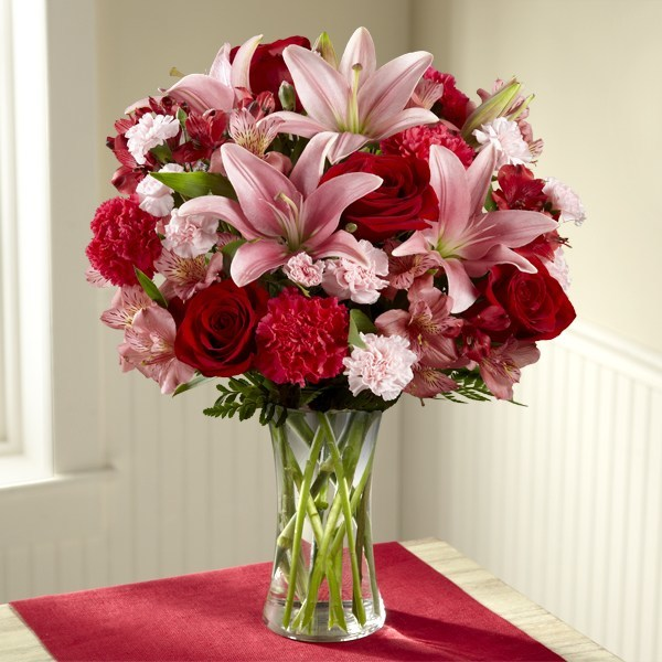 As the official floral partner to the bestselling book, The 5 Love Languages(R), which celebrates its 25th anniversary this year, FTD proudly presents The 5 Love Languages(R) Bouquet, featuring pink Asiatic Lilies, red roses, pink and red Peruvian Lilies, fuchsia carnations, pink mini carnations, lush greens and a classic clear glass vase.