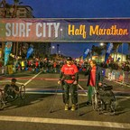 First Paralyzed Man to Walk Across the Finish Line of Surf City USA Marathon & Half Marathon