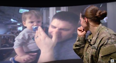 Corporal Trista Strauch is surprised by her family as she is virtually transported to the Super Bowl while stationed in Zagan, Poland. Credit: Hyundai Motor America