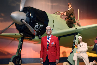 Tuskegee Airman Colonel Charles McGee stands with a WWII Japanese Zero in Hangar 37 at Pacific Aviation Museum Pearl Harbor. During his military career, Colonel McGee was awarded the Legion of Merit with Cluster, three Distinguished Flying Crosses, the Bronze Star and the Air Medal (25 times). Col McGee was the featured speaker at Saturday's Tuskegee Airmen Hangar Talk.