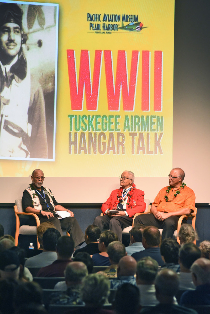 "Pacific Aviation Museum Pearl Harbor and 400 guests paid tribute to the Tuskegee Airmen and the vital role they played during World War II with a special ""WWII Tuskegee Airman Hangar Talk"" by decorated WWII Tuskegee Airman Pilot Colonel Charles McGee (center). The event commemorated African American History Month."