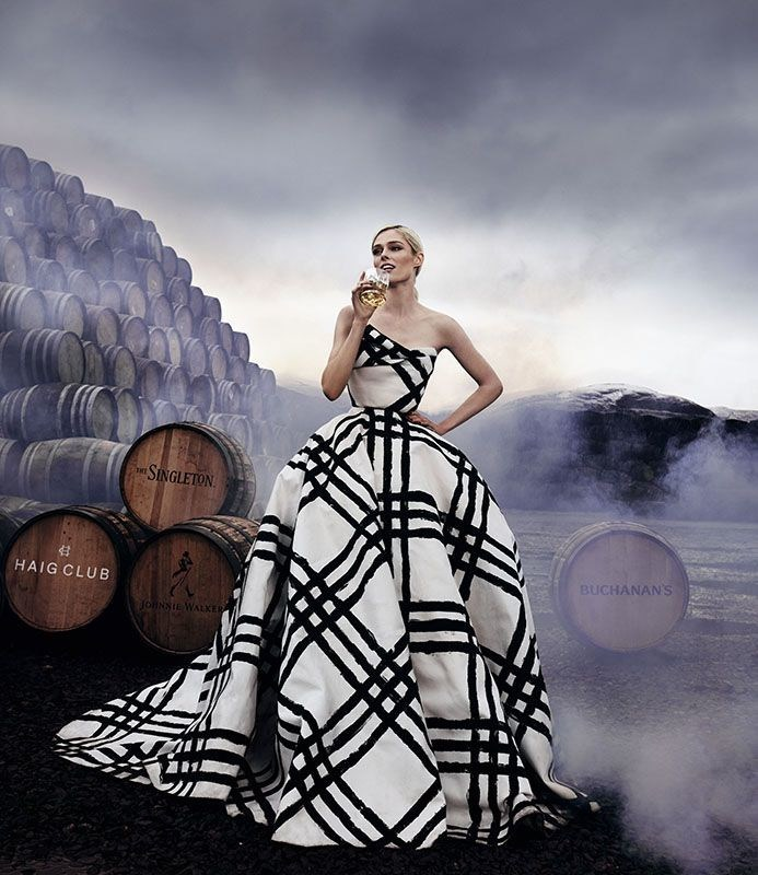 Coco Rocha, global ambassador for #LoveScotch, raising a glass against a backdrop of casks in Scotland to celebrate International Scotch Day, February 10th (PRNewsFoto/Diageo)