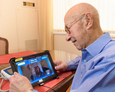 One-hundred-year-old Bernard Feinstein of Queens views the new Bluetooth-enabled telemonitoring system