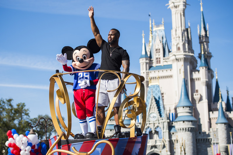 """NFL Super Bowl star running back James White starred in a milestone Disney moment Monday, Feb. 6, 2017, - """"going to Disney World"""" in a celebration parade down Main Street, U.S.A. at Magic Kingdom Park in Lake Buena Vista, Fla. White, who helped rally his team to a dramatic 34-28 overtime win over Atlanta in Super Bowl LI, continues a Disney tradition dating to 1987. (Disney)"""