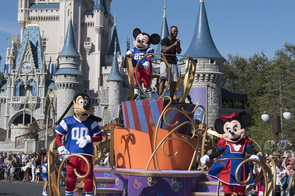 "NFL Super Bowl star running back James White starred in a milestone Disney moment Monday, Feb. 6, 2017, - ""going to Disney World"" in a celebration parade down Main Street, U.S.A. at Magic Kingdom Park in Lake Buena Vista, Fla. White, who helped rally his team to a dramatic 34-28 overtime win over Atlanta in Super Bowl LI, continues a Disney tradition dating to 1987. (Disney)"
