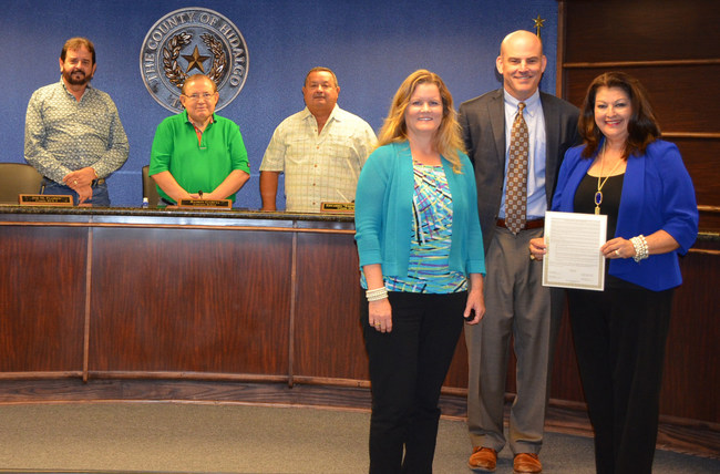 Hidalgo County Elections Administrator Yvonne Ramon (far right) presents County Commissioners' resolution to support the purchase of the Verity Voting system from Hart InterCivic. Hart's President and CEO Phillip Braithwaite and Sales Director Felice Liston offer personal assurances and answer questions about Verity.