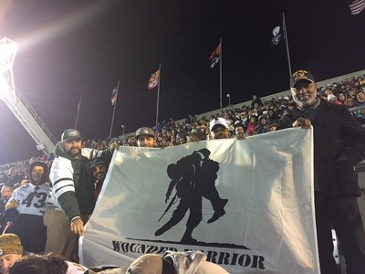 Veterans served by Wounded Warrior Project fly the flag at the Pro Bowl in Orlando, thanks to generous support from the NFL. (PRNewsFoto/Wounded Warrior Project)