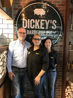 Dickey's Barbecue Pit Owner Jane Wabs, right, with business partners Angela Pasten, middle, and Chris James, left.