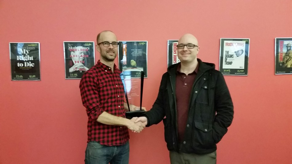 Josh Harkinson (left) receives the 2016 ASBL Journalistic Excellence Award from ASBL Communications Director Kyle Hilmoe (right).