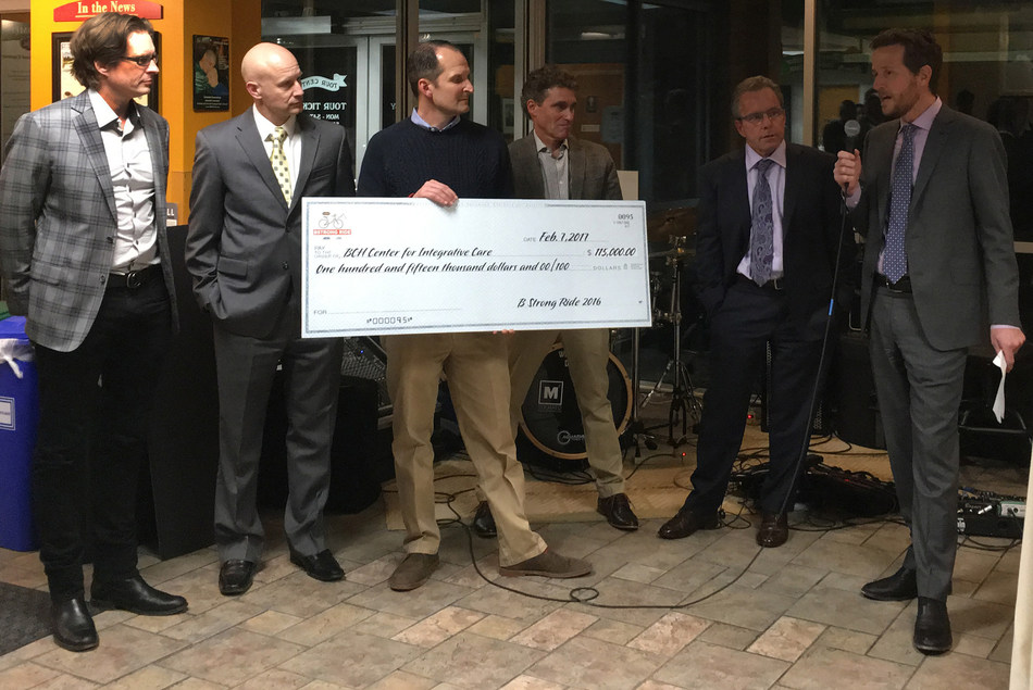 Grant Besser President of Boulder Community Health Foundation (far right) accepts a check from B Strong Ride for $115,000 to fund patient care at the Center for Integrative Care presented by Celestial Seasonings General Manager David Ziegert (Center) and the Boulder Cancer Fighters Board of Directors.