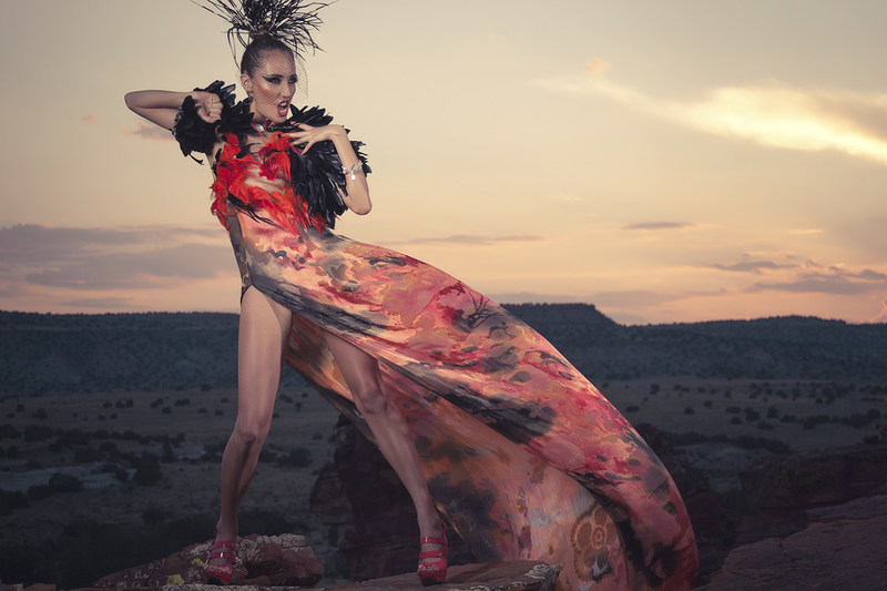 """""""Native Fashion Now"""" opens Friday, Feb. 17, at the Smithsonian's National Museum of the American Indian in New York and features the work of 67 Native American designers.  Image: Orlando Dugi (Dine [Navajo]), cape, dress, and headdress from """"Desert Heat"""" collection, 2012. Silk, organza, feathers, beads, and 24k gold; feathers, beads, and silver; porcupine quills and feathers. Model: Julia Foster. Hair and makeup: Dina DeVore. Photo by Nate Francis/Unek Photography."""