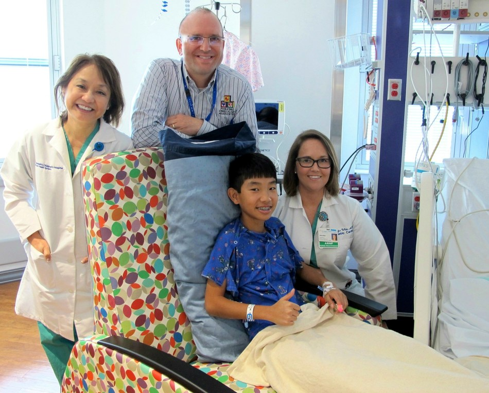 Thirteen-year-old Caleb Hancock at St. Joseph's Children's Hospital in Tampa with Pediatric Interventional Cardiologist Dr. Jeremy Ringewald, Pediatric Cardiologist Dr. Elsa Suh and Jennifer White, ARNP. Caleb was born with the congenital heart defect tetralogy of Fallot, and on Monday, Feb. 6, 2017, became the 100th patient to receive a transcatheter pulmonary valve in the hospital's Heart Institute.