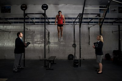 Camille Leblanc-Bazinet and Guinness judges during her attempt for most consecutive muscle ups