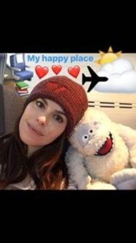 Actress Emily Hampshire boards a flight with her buddy Bumble, sporting her Heart & Stroke Roots toque. ...