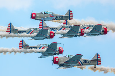 The diamond formation for the GEICO Skytypers Air Show Team crosses in an head-on encounter with the solos during their air show demonstration.