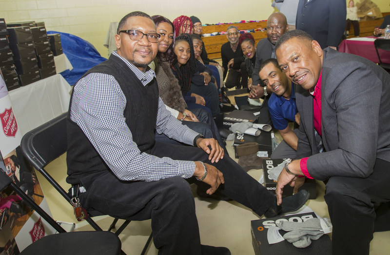 On Feb. 4, more than 200 low-income and homeless residents of greater Baltimore received new boots and socks from Toyota Financial Services. The event took place at The Salvation Army Boys and Girls Club at Middle River. Right Side from Front to Back: John Ridgeway of Toyota Financial Services, Jade Merrick of Toyota Financial Services, Tim Hale of Toyota Financial Services, the comedian Meshelle, Robert Hatchett Jr. of Toyota Lexus Minority Owners Dealership Association