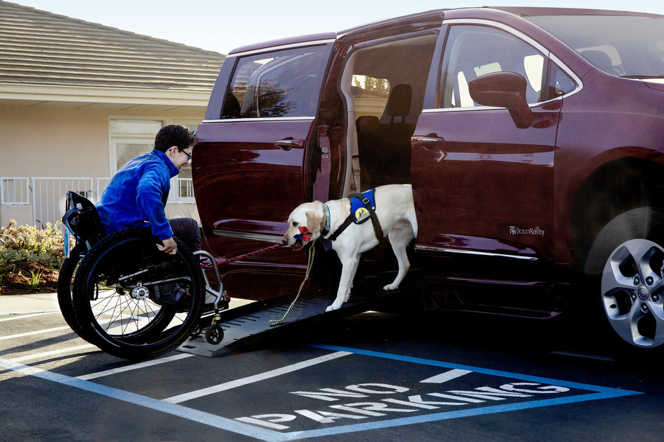 Wallis Brozman (Corporate Marketing Assistant | Canine Companions for Independence) with her canine companion Mork outside the Canine Companions for Independence Headquarters in Santa Rosa, California. (Photo Credit: Chrysler brand | FCA US LLC)