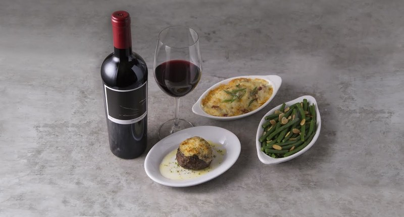 Petite Filet Mignon with Horseradish Crust, served alongside Gratin Potatoes Romanoff and Green Beans Almandine. Paired with Cuttings, a Cabernet Blend with Petite Sirah and Syrah from The Prisoner.