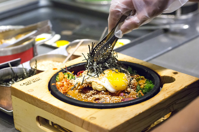 Bibigo's Signature Sizzling Hot Stone Build-Your-Own Bibimbap Bowl, a traditional Korean dish