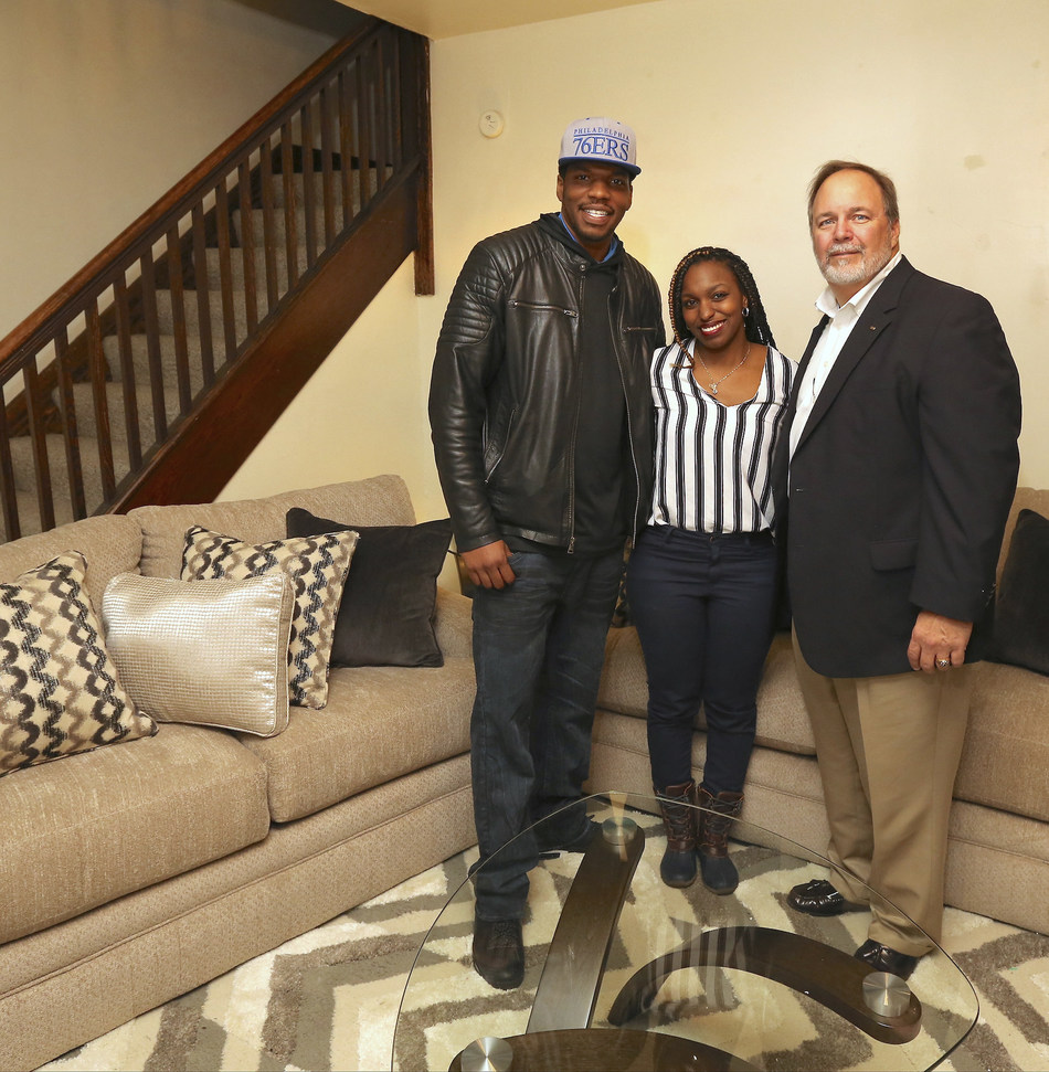 """Aaron's, a leader in the sales and lease ownership and specialty retailing of furniture, consumer electronics, home appliances and accessories, delivered an entire home makeover of new furniture, appliances and electronics to (L to R) Anthony Harper and Jasmine Dobbs pictured with Aaron's Director of Franchise Operations Ray Muncy.  The Dobbs family of Granville, West Virginia, was recently surprised as the grand prize winner of the """"Big Blue Bow Home Makeover"""" on """"The Wendy Williams Show."""""""