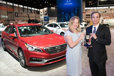 Scott Margason, director, product planning, Hyundai Motor America accepts 2017 U.S. News & World Report Best Midsize Car for the Money trophy for the 2017 Hyundai Sonata from Jamie Page Deaton, managing editor, US News.