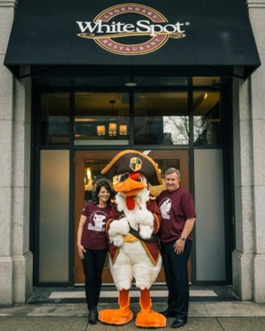 White Spot's Vice President of Marketing and Menu Development Cathy Tostenson, 'Captain Beak Rogers' and President Warren Erhart celebrate the launch of The Cluckaneers – the first 3D augmented reality kids program by a Canadian restaurant chain – at the Dunsmuir Street location in Vancouver. (CNW Group/White Spot)