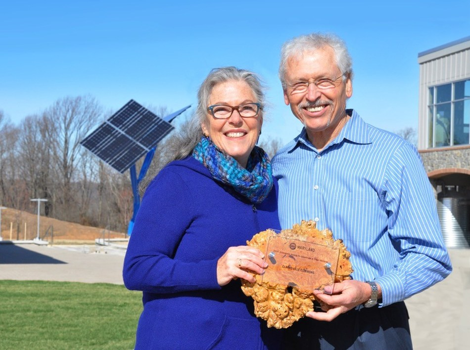 Holly and George Stone, principals of GreenStone Ventures, the developers of Clarksville Commons, proudly display their 2017 Wintergreen Award for Excellence in Green Building by the United States Green Business Council (USGBC) Maryland.