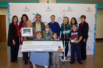 Patients and staff were all smiles at the check presentation in the Loma Linda University Children's hospital lobby.