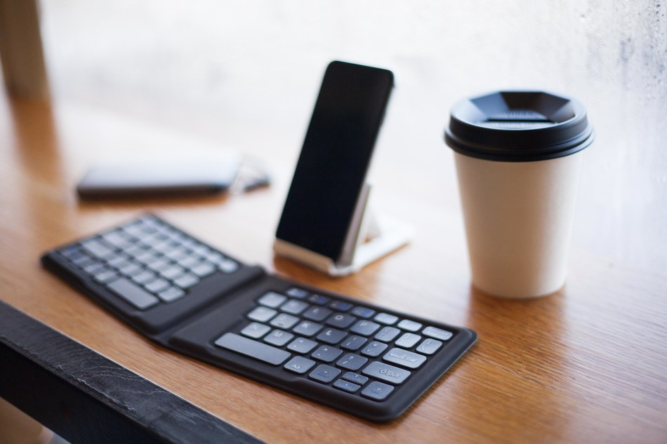 This universal keyboard is compatible with iOS, Android and Windows devices and uses Bluetooth to wirelessly connect to and switch between up to four devices. Additionally, it features an ergonomic V-shape layout, providing a stylish yet comfortable typing experience that can easily fit in your pocket.