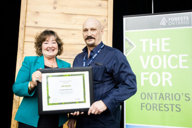 The Honourable Kathryn McGarry, Minister of Natural Resources and Forestry, presenting Jeff Muzzi with the ...