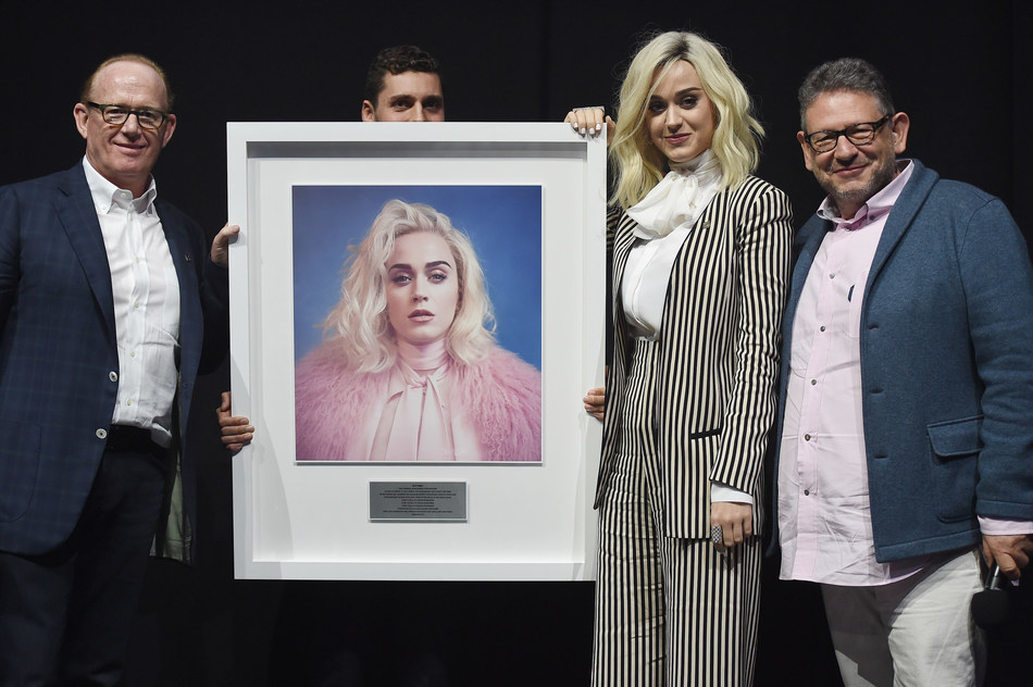 (pictured L-R Steve Barnett; Chairman & CEO Capitol Music Group, Katy Perry, Sir Lucian Grainge; Chairman and CEO Universal Music Group)