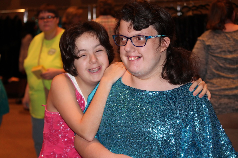 Two Guests of Night to Shine in their Donated Dresses