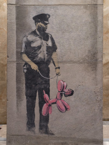 This is an image of the Banksy piece, comprised of three pieces of concrete that were reassembled and are now installed in the PATH network at One York Street. (Image supplied by Menkes Developments; Photo by Paul Casselman) (CNW Group/Menkes Developments Ltd.)