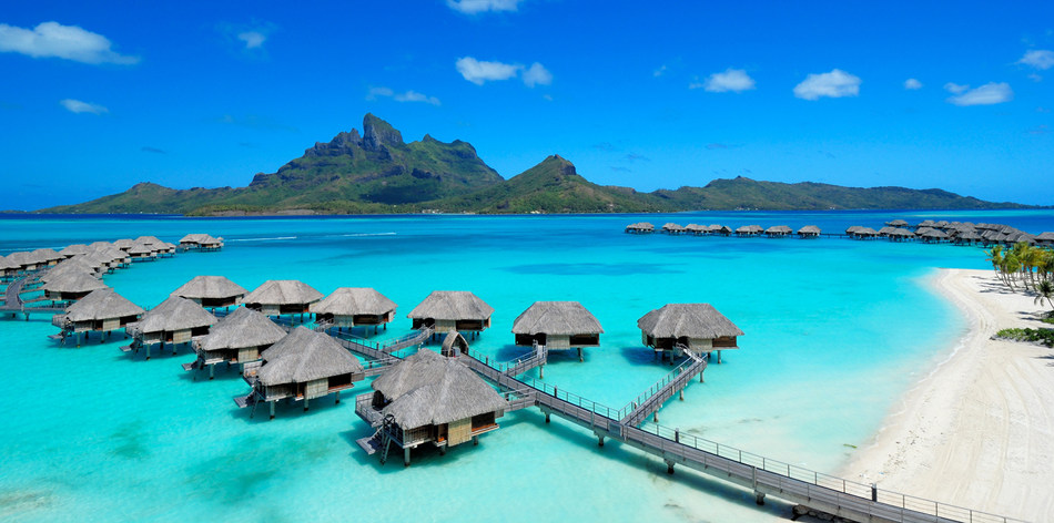 """Paying homage to the year of the first overwater bungalow, Four Seasons Resort Bora Bora introduces the 50th Anniversary Package, which includes a euro1,967 resort credit, to be used by guests on resort charges such as dining, activities and spa experiences. Additionally, guests booking this package will receive a """"Make Your Own Mai Tai"""" kit, allowing them to further celebrate this occasion with French Polynesia's most famous cocktail."""