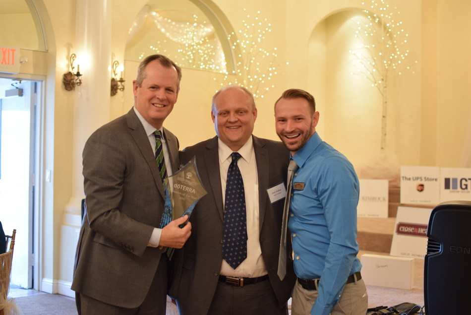 Corey Lindley, President & CFO of doTERRA International, receives the Business of the Year Award on Behalf of doTERRA from Josh Walker and Dustin Cook of the Pleasant Grove-Lindon Chamber of Commerce. doTERRA, the world leader in essential oils, sources the highest quality oils from more than 40 countries around the world and has more than 2400 employees worldwide.