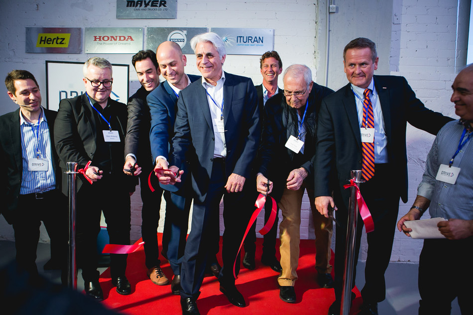 Michel Taride, Group President, Hertz International (middle) and the DRIVE Innovation Center launch team mark the opening of the new smart mobility center in Tel Aviv
