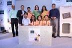 From Left to Right - Vinay Adhe, Sahakari Bhandar; Jaideep Gokhale, Comm Director, Tetra Pak S. Asia Mkts; Manisha Mhaiskar, Principal Sec, MoUD, Govt. of Maharashtra; Monisha Narke, Founder, RUR Life; Damodar Mall, CEO, Reliance Retail with students (PRNewsFoto/Tetra Pak)