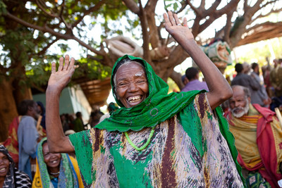Harar, Ethiopia. An elderly cataract patient joyfully ululates after realizing her eyesight has been fully restored. Photo: Amanda Conde/HCP