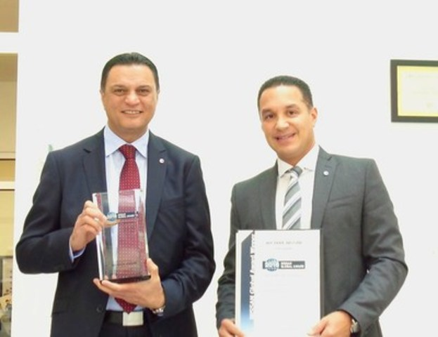 401 Dixie Nissan was awarded the prestigious Nissan Global Award, presented by Nissan Motor Company to General Manager Sohail Iqbal (left) and Regional Director Omar Khan (right). (CNW Group/Dilawri Group of Companies)