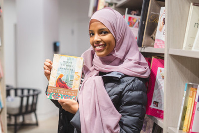 Photographer Yasin Osman captures photos of Canadians reading at their local Indigo stores. (CNW Group/Indigo ...
